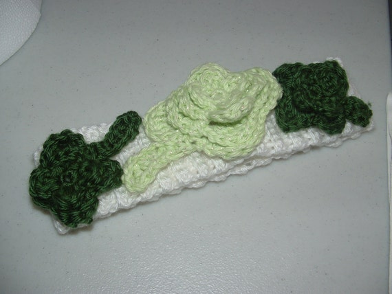 Crocheted shamrock head band in green and white