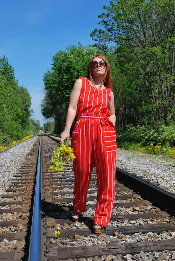 Perfectly Pin Striped 1980s Vintage Holiday Orange And Pink Sleeveless Striped Jumpsuit With Pockets