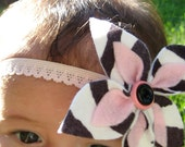 Zebra print floral headband with pink and black buttons