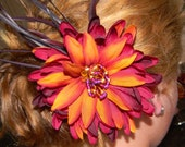 Flower Hair bow with colors of purples, oranges and yellows with hand sewn glass beads and feathers.