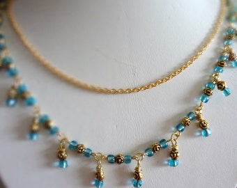 Rose Necklace in Gold with Light Blue Accent Beads Floral Necklace