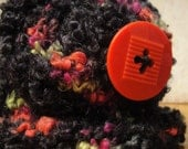 Bulky knit newborn hat with tangerine button