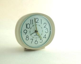 Vintage creamy alarm clock
