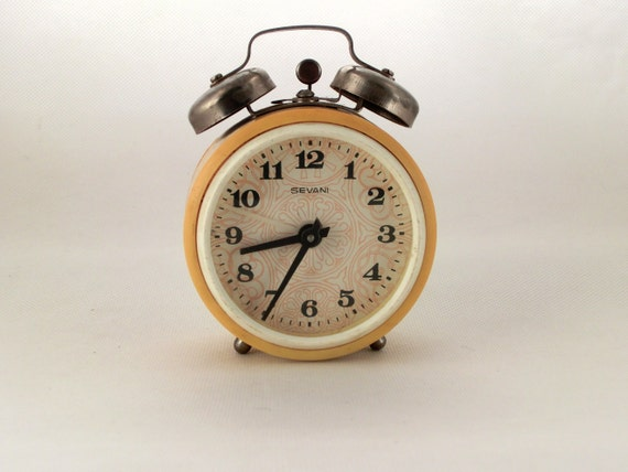 Vintage yellow alarm clock made in Russia