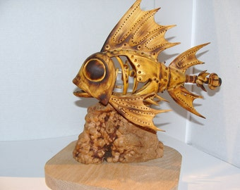 Hand carved mechanical fish with moving jaw when propeller turned.