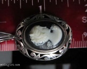 Steam Punk Jezlaine Sterling Silver Cameo with black background, white figure