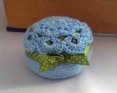 Blue crochet pincushion - round tuffet with green polka dot ribbon