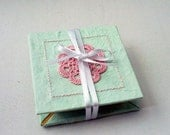 Expandable pocket photo book in mint green with pink crochet motif