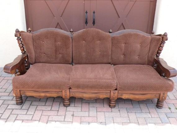 Listing for Etsy member: Albertblaise Vintage Turned Wood Sofa Couch - Black frame - Blue velvet fabric