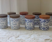 Vintage French country set of 8 little spice storage cannisters / jars.