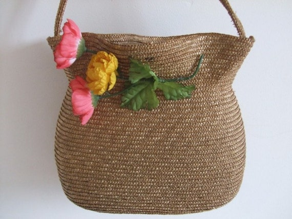 The most adorable little vintage French straw bag.  Look at the shape of the top....  perfect decoration.  Country cottage chic