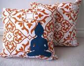 Bold modern orange damask print pillow cover with colorful applique buddha silhouette, made from recycled fabric