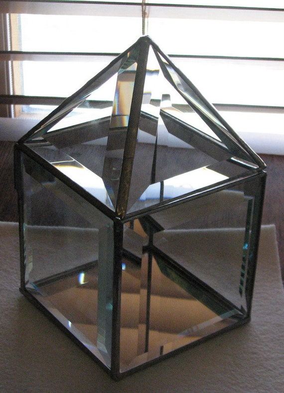 Clear beveled glass box 4 x 4  x 7 inches  with a pyramid shaped hinged lid