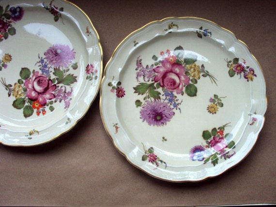 A pair of  Exquisite Berbardaud Limoges plate with a floral pattern and gold trim.