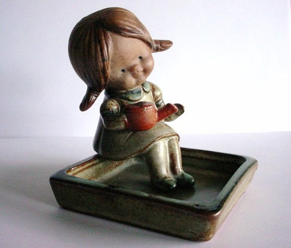 UC CTI Japan Clay Figurine - Vintage Little Girl Sitting with Watering Can In A Planter Box