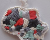 Handmade embroidered Africa ornament with mint green pink and gray