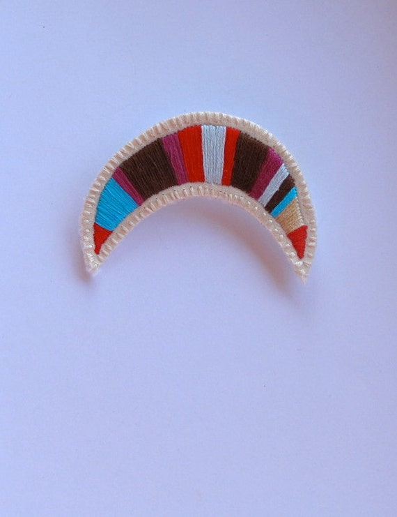 Handmade crescent brooch embroidered violet blue brown red ice blue and tan Southwest influence