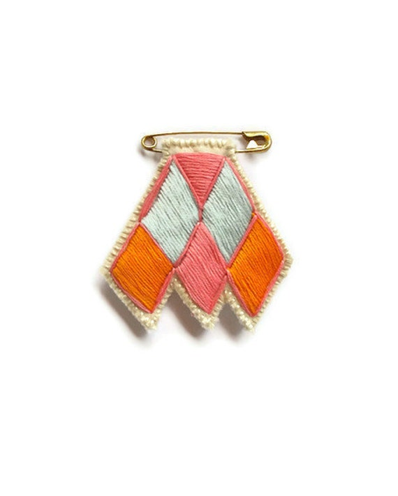 Diamond chevron brooch on safety pin embroidered pink silver gray and orange colorblock