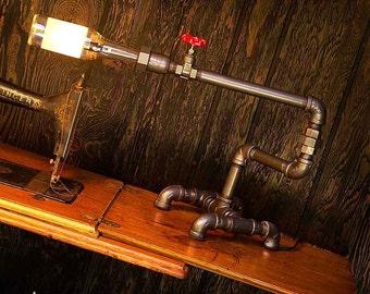 Desk Lamp. Beer bottle, Plumbing pipe and fittings.