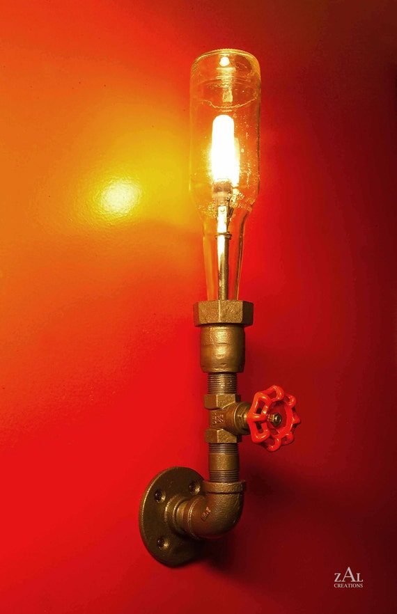 Wall Light. Lamp. Beer bottle, Plumbing pipe & fittings. Wall light .  Lighting Fixture. Sconce