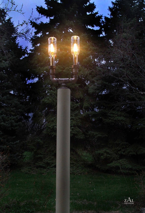 Pole  Lamp. Beer bottles, Plumbing pipe & fittings. Wall lamp. Lighting Fixture.