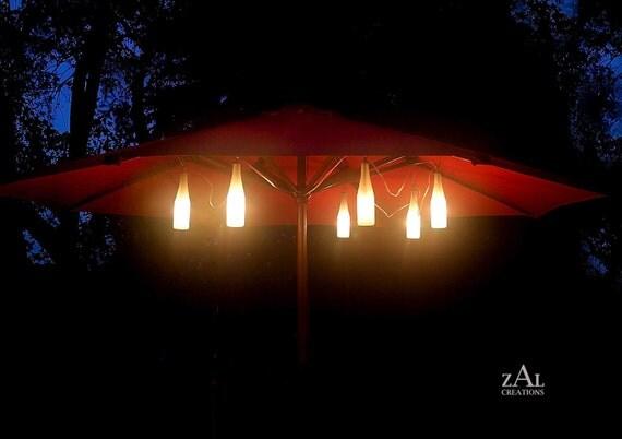 Umbrella lights. Accent lights. Six Beer bottles. String lights.