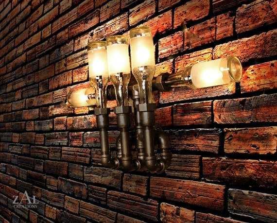 Wall Lamp. Beer bottles. Plumbing pipe & fittings. Wall light. Lighting Fixture. Sconce.