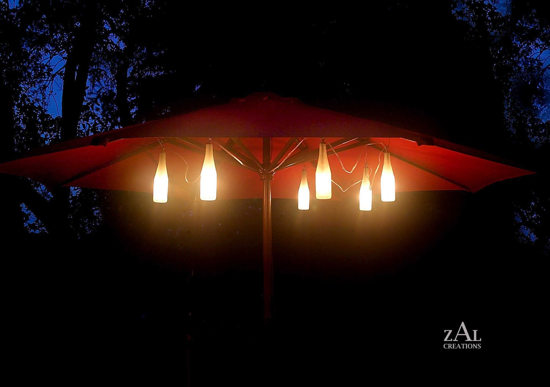 String Lights On Umbrella : Umbrella lights. Accent lights. Six Beer bottles. String