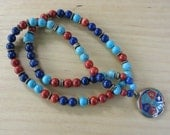 Lapis, coral & turquoise beads with a Tibetan sacred syllable pendant