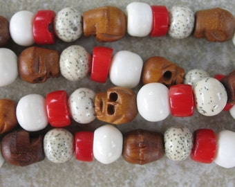 Unique 108 mala with wooden skull, bone, coral, and white bodhi beads