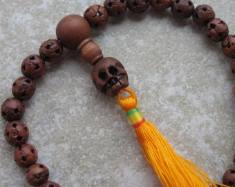 Pocket mala with carved wood lutong beads and yellow tassel