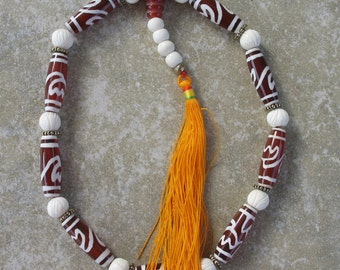 Nine dzi Buddhist prayer mala with the double lotus