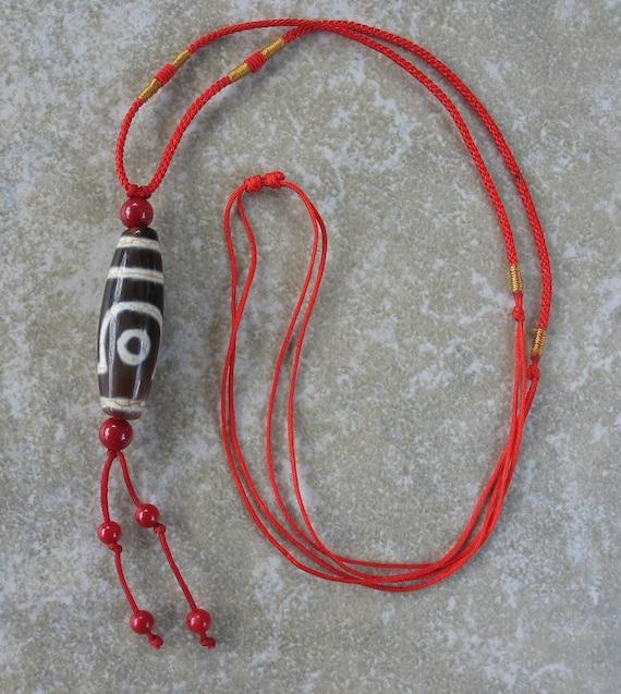 Two-eyed dzi bead pendant necklace