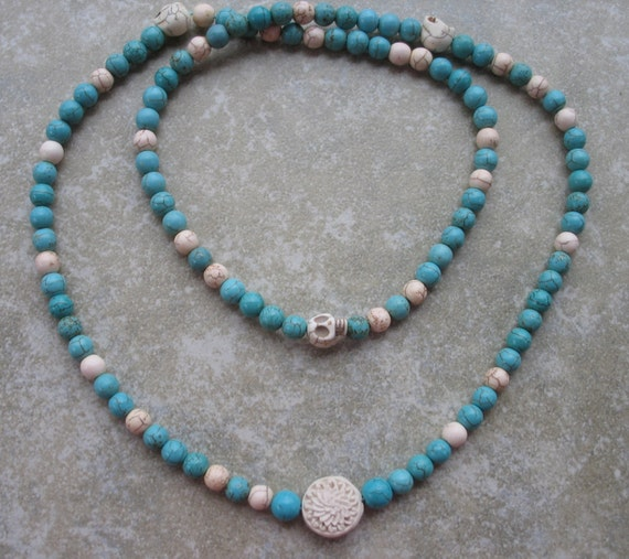 108 Buddhist mala in turquoise howlite with white cinnabar focal