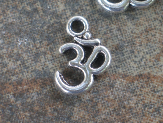 Om pendant in Tibetan silver - very tiny - sold by the dozen