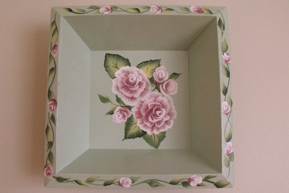 Hand painted bouquet of pink roses framed with pink rosebuds on soft green background