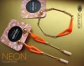 Neon orange bracelet and neon earrings combo. Hot neon orange friendship bracelet and earrings. Orange neon matching bracelet earrings.