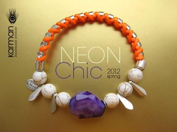 Neon rhinestone bracelet. Trendy orange neon rhinestone bracelet with large purple stone. Orange neon bracelet by Karman Jewelry.