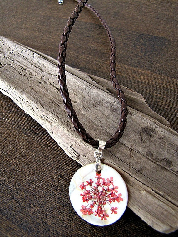 Red pressed flower necklace with braided leather cord