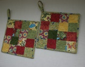 Pot holder, hot pad, kitchen decoration, modern in green, gold and red.