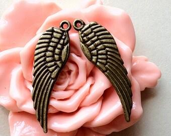 30 x 10 mm Medium Size Antique Bronze Angel Wing Charms (.tn)