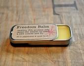 Lip balm peppermint sweet birch scent beeswax balm in .25 oz slide tin, brown cream beige yellow