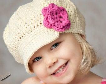 Cream Brimmed Hat with Pink Flower