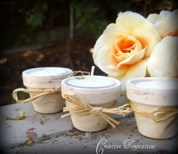 Set of ten Distressed tealight holders with tealights
