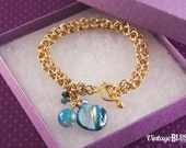 Gold plated chainmaille bracelet with charms