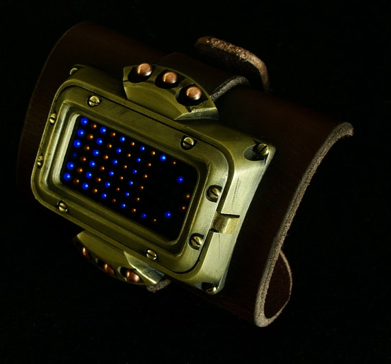Steampunk wrist cuff with working watch and date.