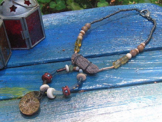 The Voyage - Handmade Ammonite, Roman glass pieces, Tibetan beads, shell, ceramic, petrified bone, African trade beads and steel necklace