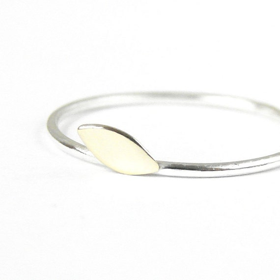 Skinny silver ring with a gold tone brass leaf.