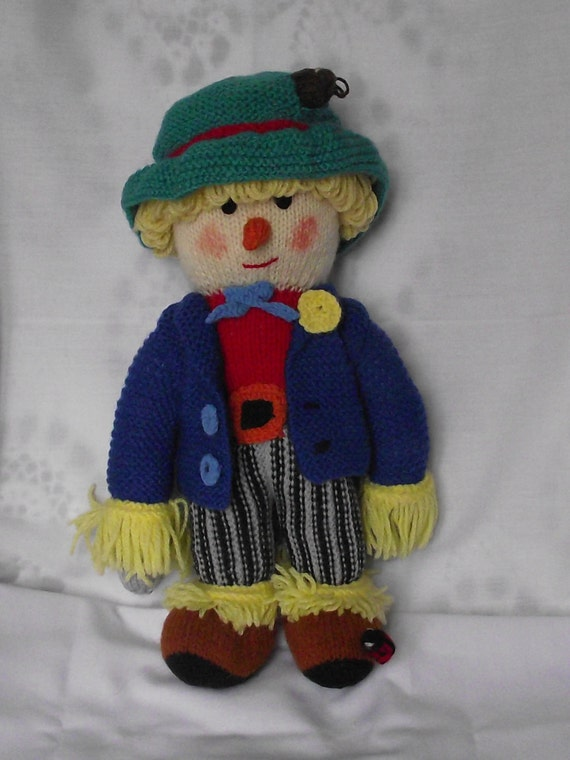 Hand Knitted Scarecrow doll./ with a  tiny mouse poking out of his hat