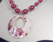 big pink pearl baubles with large shell donut focal medallion textured gold tone beads adjustable size chain